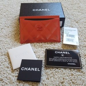 Authentic CHANEL O-Card Case Coral Patent Leather